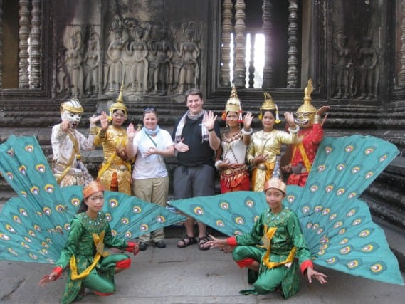 posing with dancers in cambodia thanks to our budget and saving for the trip