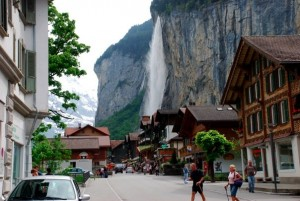 view of famous waterfall behind town in lauterbrunnen switzerland during a road trip