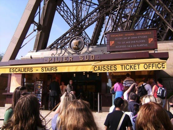 eiffel tower, paris france europe, buy tickets, take stairs to top of eiffel tower, vacation, backpacking, peanuts or pretzels travel blog
