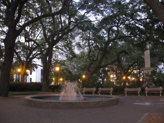 A beautiful square in Savannah at twilight. Fountains, lights, and moss trees. Georgia