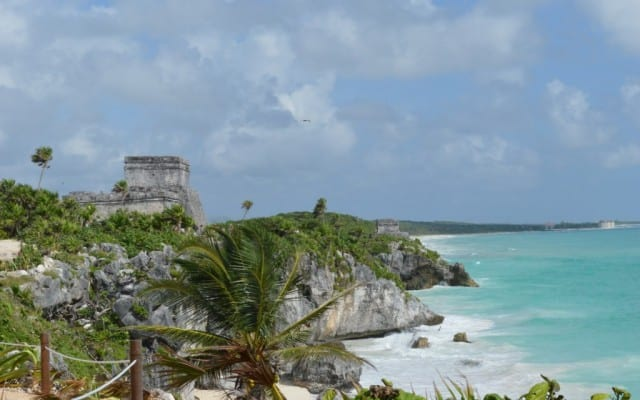 The Tulum Ruins, Mexico are perched on the edge of the Caribbean Sea