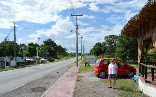 Having parked our red rental car, Liz is standing outside as we walk to get tacos for lunch in a small town in the Yucatan during our road trip