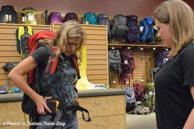 sizing and fitting a backpack, REI backpack fitting,