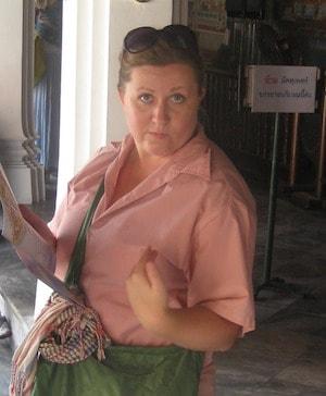Liz's model's her rented shirt at the Grand Palace Bangkok, Thailand