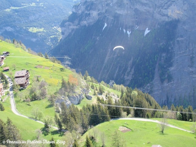 See that parachute? That's Liz paragliding in Switzerland after running off this mountain in the Alps!