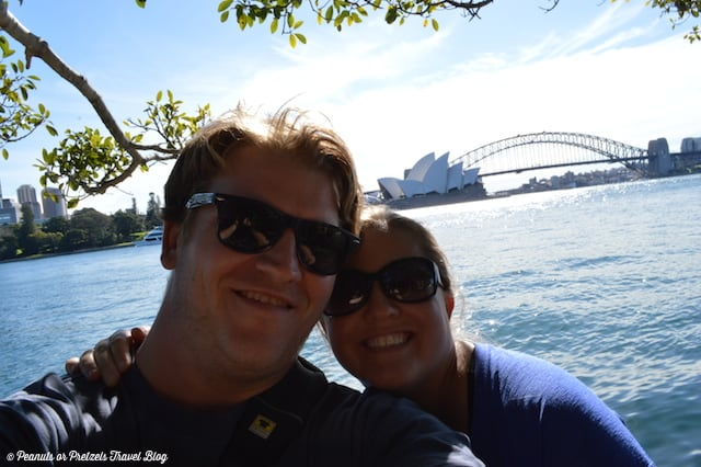Saving money for travel allows us to sit here in front of the Sydney Opera House and bridge in Australia on a dream vacation!