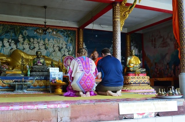 Getting blessed by a monk in Thailand