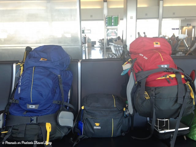 our backpacks sitting on chairs in airport ready for air travel