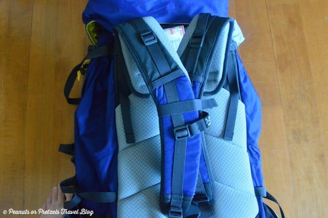 close up of travel backpack with shoulder straps tied together for safe travel on an airplane when checked baggage