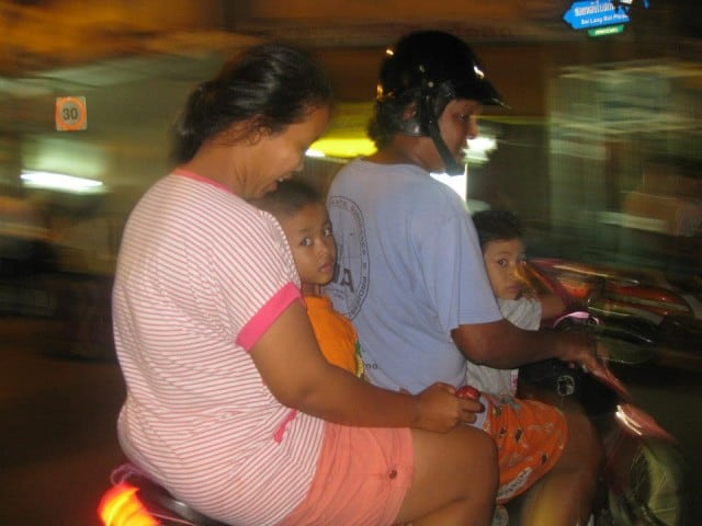 Yes, that is a family on a motorbike. And is a conservative number of people on the bike!