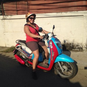 """The first motorbike I mastered riding in Thailand. It was a bit girly - so we later exchanged it for a more """"manly"""" bike!"""