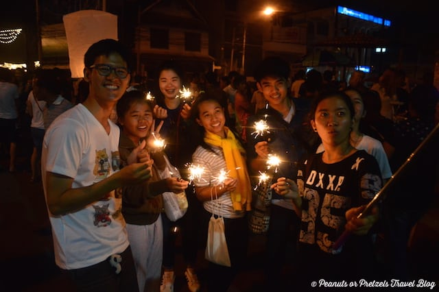 A young group of Thais enjoying the Loy Krathong festivities in Chiang Mai, Thailand