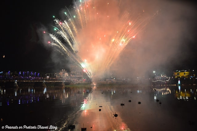 Enjoying a fireworks display along the Ping River, just after launching our Krathongs in the river