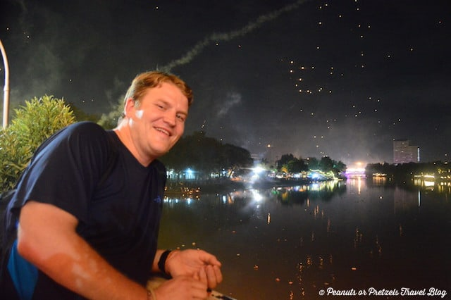 Enjoying the view from the Iron Bridge in Chiang Mai of the Loy Krathong Festival in Thailand.