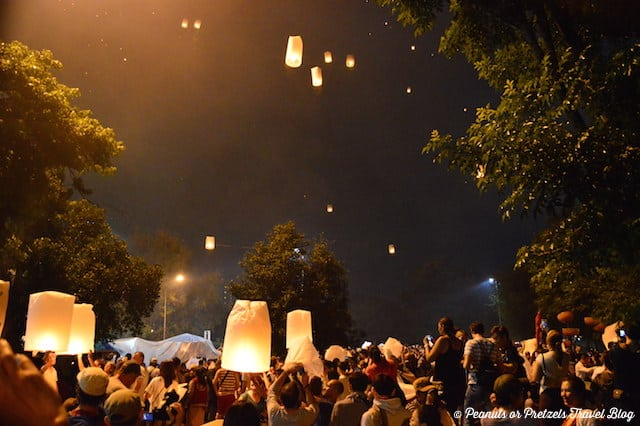 Groups sending off Khom Loi (paper lanterns) from a local park in Chiang Mai, Thailand