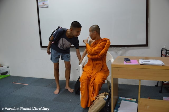 Teaching a Lesson - Peanuts or Pretzels, monk in thailand, monk from thailand, meeting with a monk