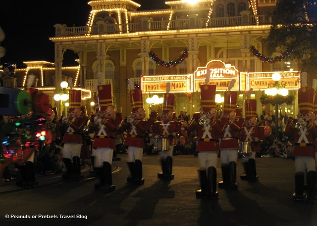 Life-size toy soldiers march in unison at Disney's Christmas parade!