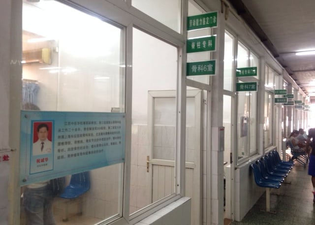 At a Chinese public hospital, you walk down the hallway to find your doctor.