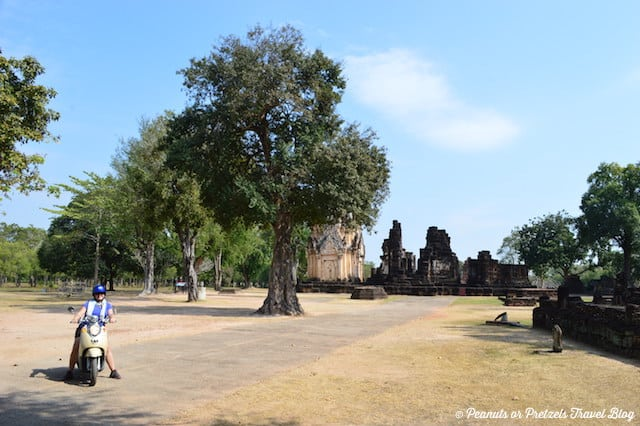 Liz riding around Sukhothai Thailand on a motorbike exploring temples.