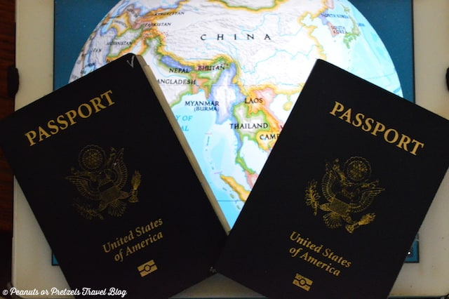 two USA passports on a map prepare these for international travel checklist