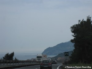 driving a rental car along the coast of northern italy into france along the mediterranean sea