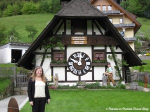 Liz standing in front of a giant life-sized coo-coo clock during our road trip in Germany