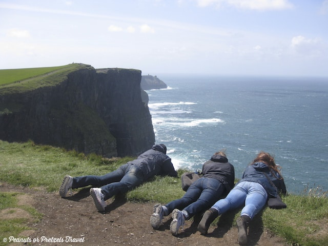 Cliffs of Moher in Ireland, lay on the cliff in ireland