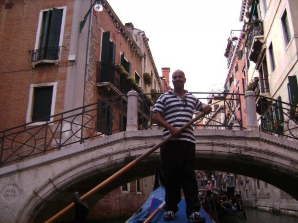 Our Gondolier in Venice - taking care to duck under those bridges!