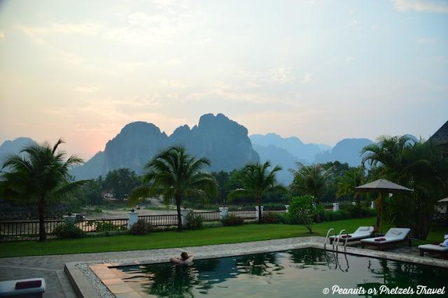 Sunset poolside at Riverside Boutique Resort, Vang Vieng, best time to visit vang vieng, Laos