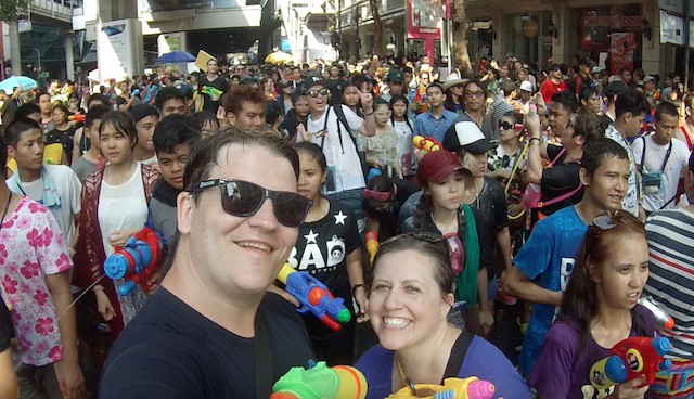 crowd of people at the songkran festival in bangkok thailand with water guns