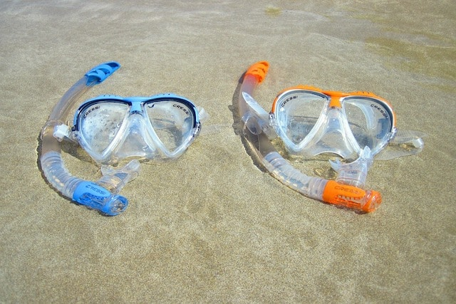 snorkel and mask gear on beach