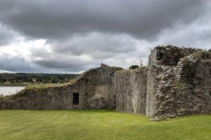 castle ruins in ireland with weather clouds