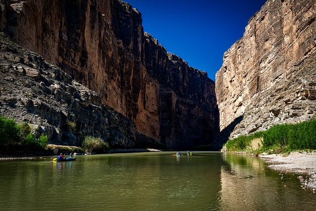 Rafters floating the Rio Grande in Big Bend National Park steep canyon walls