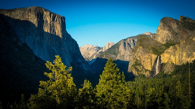 view of yosemite valley with cliffs and waterfalls