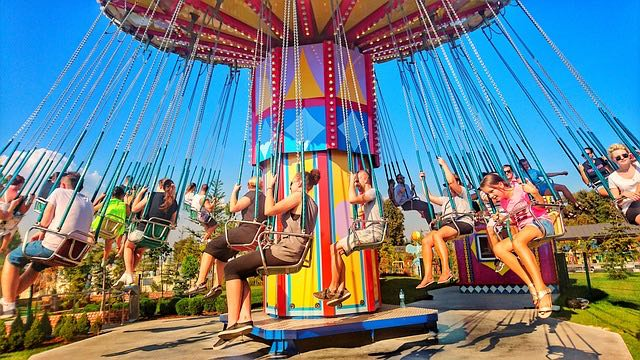 people on swings carousel having fun things to do on vacation